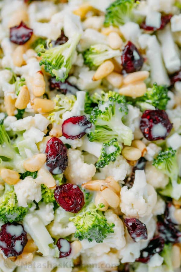 This broccoli cauliflower salad only has 7 ingredients (including dressing!). Delicious winter salad/ Christmas salad and can be made in advance - it's perfect for parties!