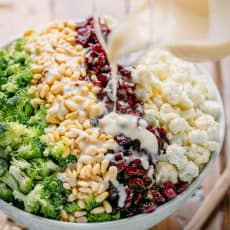broccoli cauliflower salad drizzled with creamy dressing