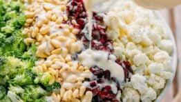 broccoli cauliflower salad drizzled with creamy dressing