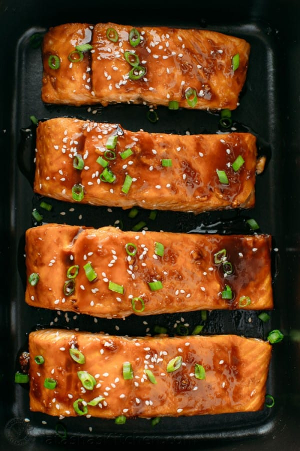 Teriyaki glazed salmon arranged in serving platter with serving suggestion for teriyaki salmon