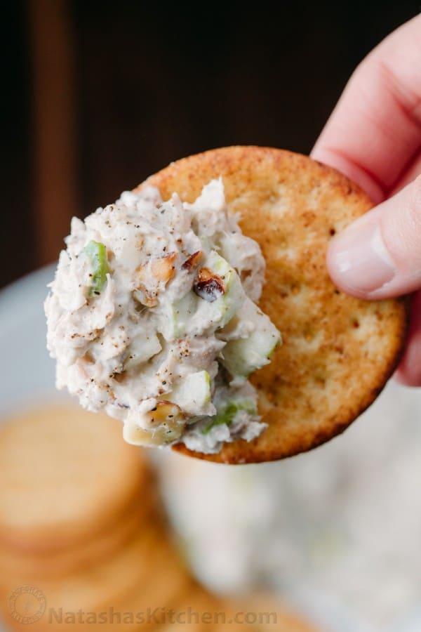 Cracker dipped into tuna salad, tuna salad serving ideas