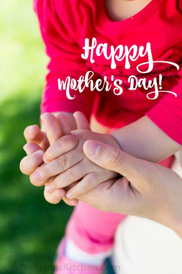 A photo of a mother and daughter holding hands that says happy mother\'s day