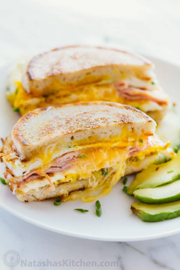 This breakfast sandwich is cheesy, juicy, easy and so delicious! All you need is 5 minutes and 5 ingredients. A one-pan breakfast sandwich recipe with video | natashaskitchen.com