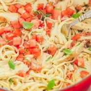 This chicken pasta has a creamy and light tomato alfredo sauce. The sauce has very little cream but it tastes gourmet! An easy chicken pasta recipe. | natashaskitchen.com