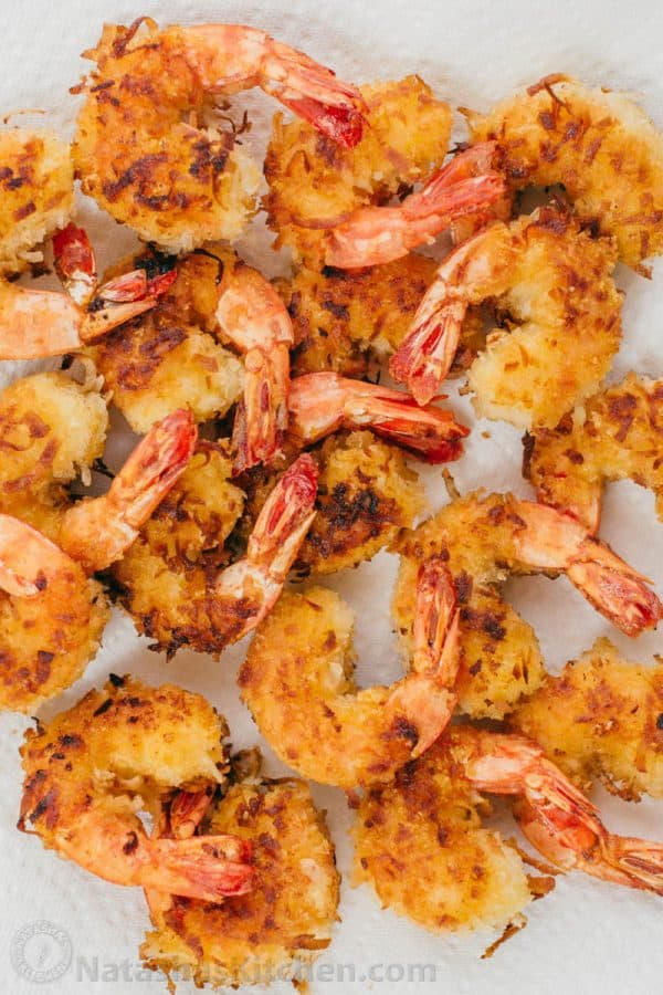 These Coconut shrimp are coated in plenty of coconut for superior crunch and subtle tropical flavor. The 2 ingredient dipping sauce for coconut shrimp will win you over and it's so easy! | natashaskitchen.com