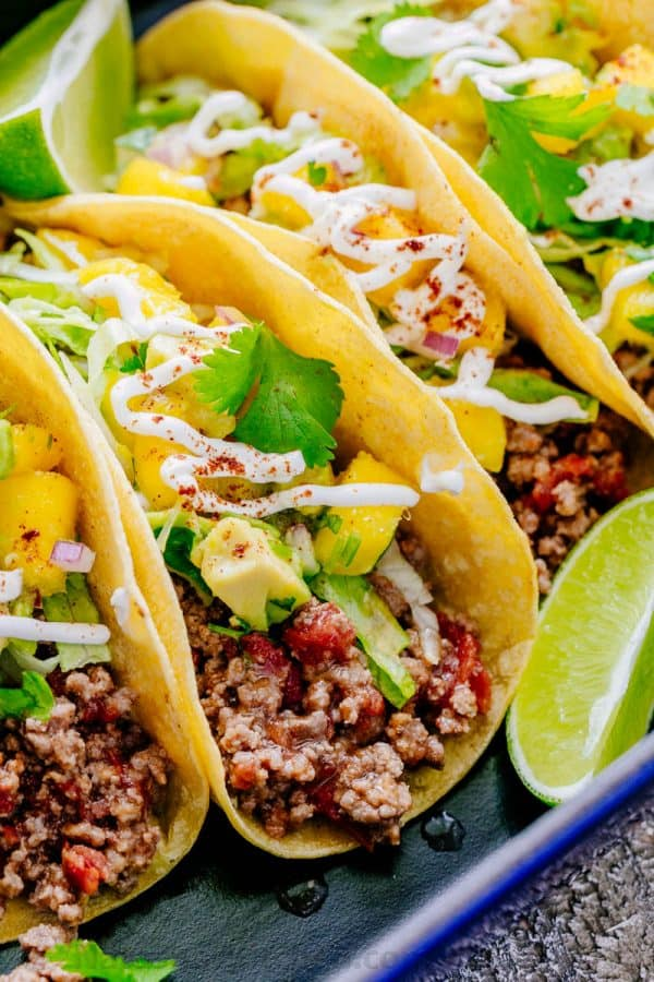 Throw a beef taco PARTY! These juicy beef tacos are loaded and topped with mango salsa. Beef tacos are fun to serve and eat. Fresh, healthy and satisfying!   natashaskitchen.com
