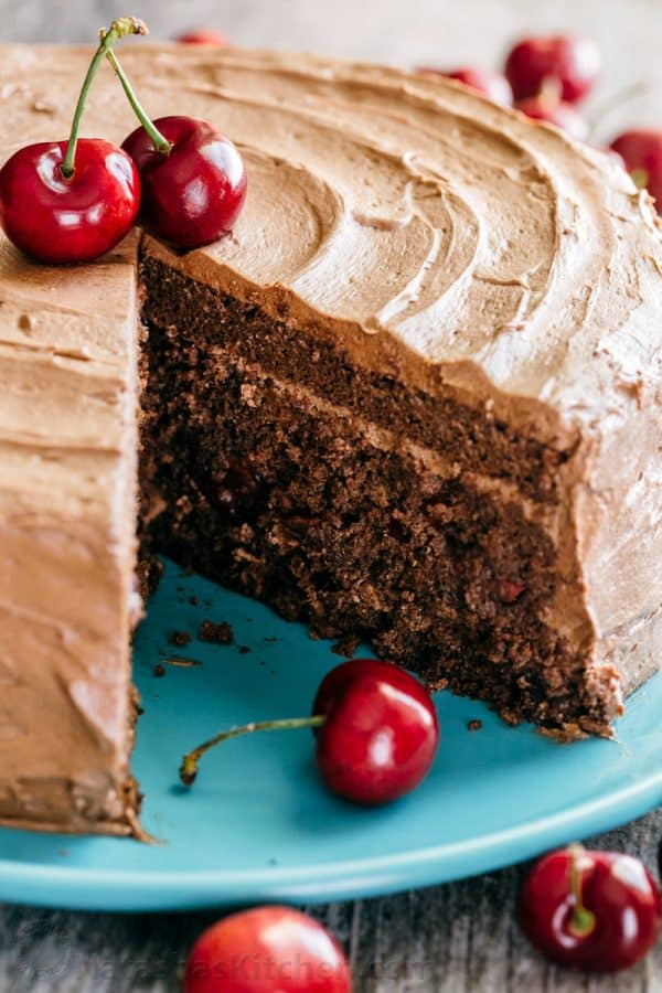 Decadent but simple chocolate cherry cake. Kirsch and cherries amplify chocolate in an intense and delicious way. The moist filling in this chocolate cake will surprise you! | natashaskitchen.com