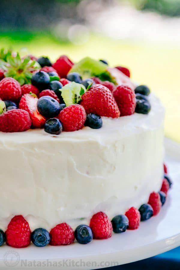 Kiwi Berry Cake - you have to see what's inside this stunning and delicious cake! | natashaskitchen.com