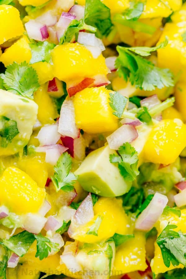 Close-up of Fresh Mango Salsa with avocado, mangos, red onion, and cilantro