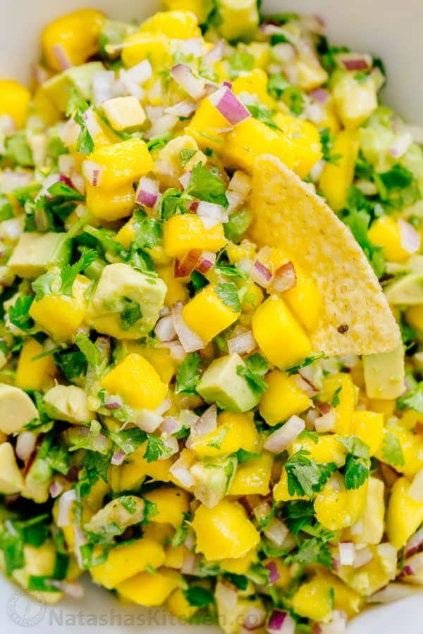 Easy Mango Salsa served on a tortilla chip