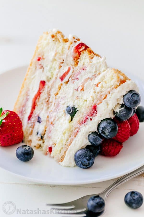 The most STUNNING Berry Tiramisu you'll make - bring this to a party and watch people's eyes light up. Berry Tiramisu is SURPRISINGLY SIMPLE to make. Step-by-step photos! | natashaskitchen.com