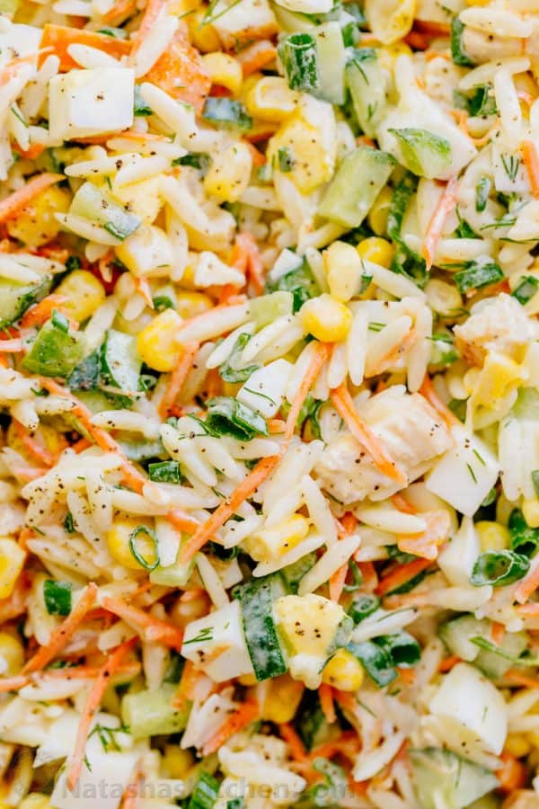 This chicken pasta salad is loaded, hearty and satisfying. The creamy lemon dill dressing adds fresh amazing flavor. This pasta salad is so tasty! | natashaskitchen.com