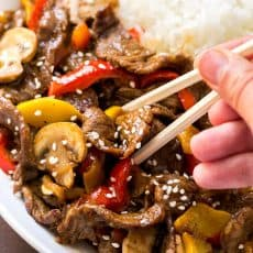 MUST TRY quick beef stir-fry recipe loaded with mushrooms, bell peppers and zucchini. Serve beef stir-fry over steamy white rice. The easy sauce will surprise you! | natashaskitchen.com