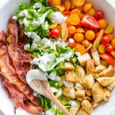 A BLT Salad loaded with fresh lettuce, crispy bacon, bright tomatoes, crunchy croutons and the BLT Salad dressing is exceptional. Easy, excellent salad! | natashaskitchen.com