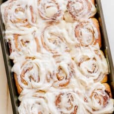 Melt-in-you-mouth overnight cinnamon rolls with whipped cream cheese icing. Perfect for holidays and busy mornings. The best make-ahead cinnamon rolls! | natashaskitchen.com