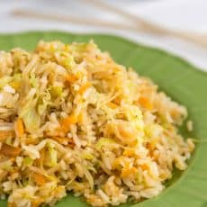 A green plate of cabbage fried rice