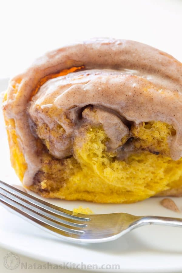 You'll make this Pumpkin Bread over and over. Cinnamon rolls + pumpkin pie + amazing cinnamon glaze = this pull-apart pumpkin bread! It melts in your mouth! | natashaskitchen.com