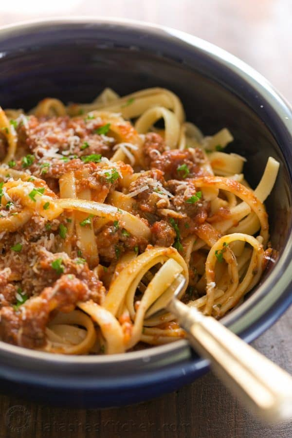 Good bolognese sauce (Italian Ragu) is cooked slowly, puttering away as deep meaty flavors develop. This slow cooker bolognese recipe couldn't be easier! | natashaskitchen.com