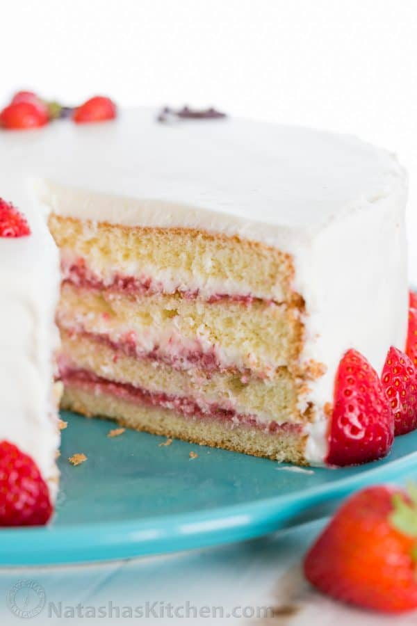 This fresh strawberry cake is definitely a reader favorite! Completely charming, not overly sweet and tastes bakery quality. Video tutorial on How to Make Strawberry Cake! | natashaskitchen.com