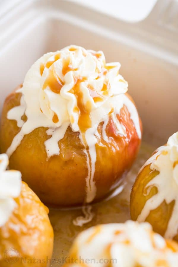 Stuffed Baked Apples Recipe topped with whipped cream and caramel sauce