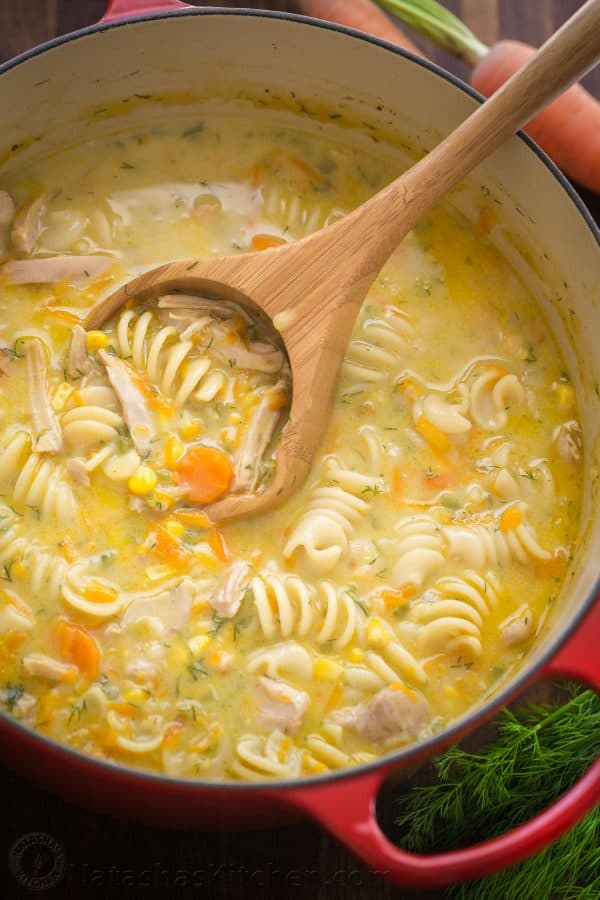 Creamy Chicken noodle soup served in a dutch oven with a ladle