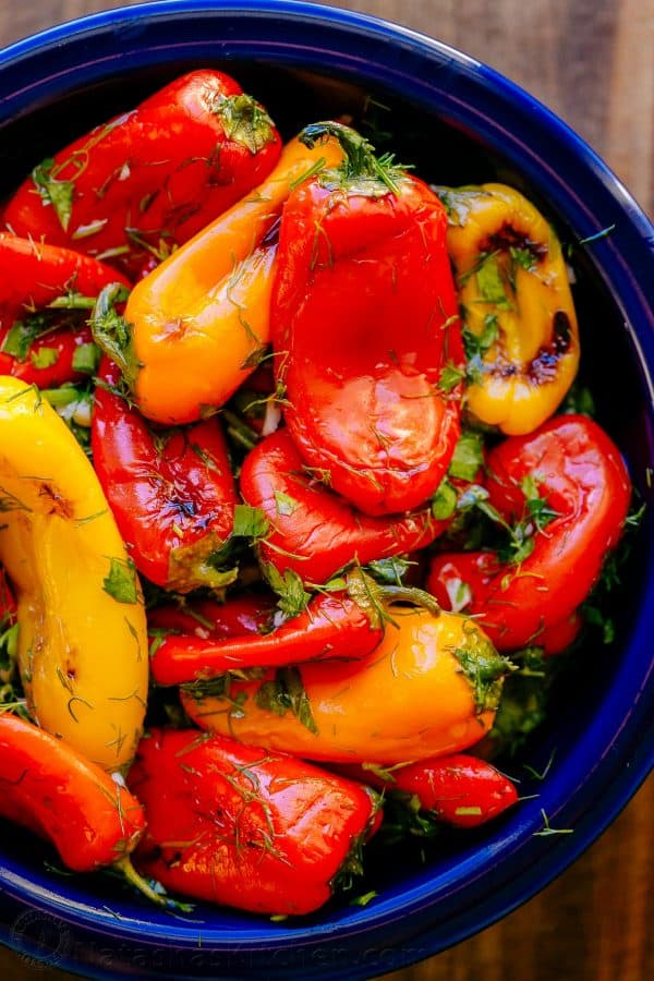 Marinated sweet peppers in blue bowl