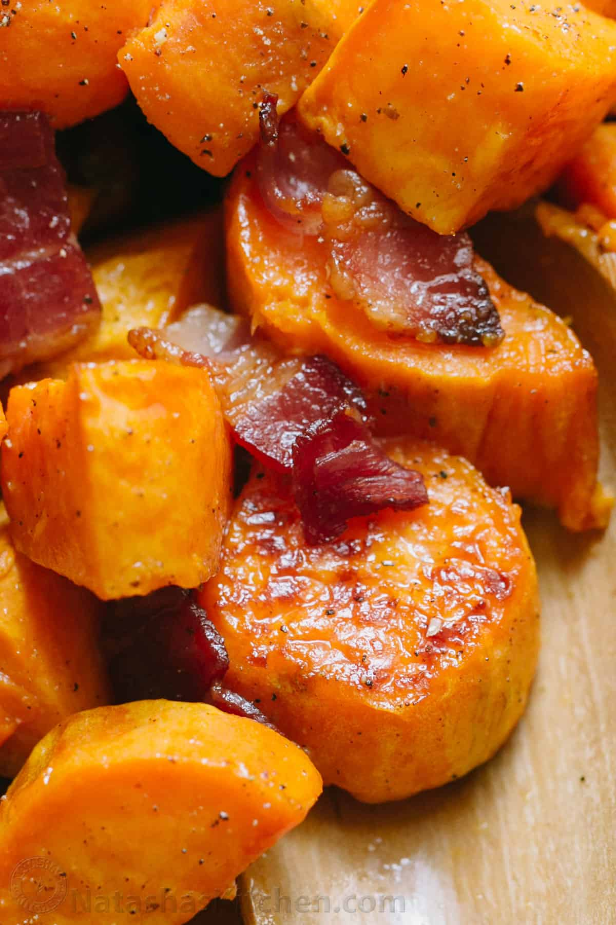 Up close pieces of roasted sweet potatoes and bacon