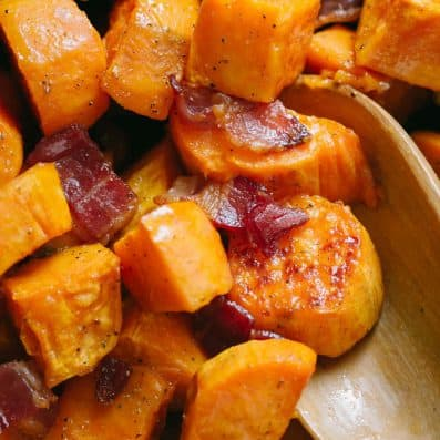 Maple Roasted sweet potatoes with bacon and serving spoon