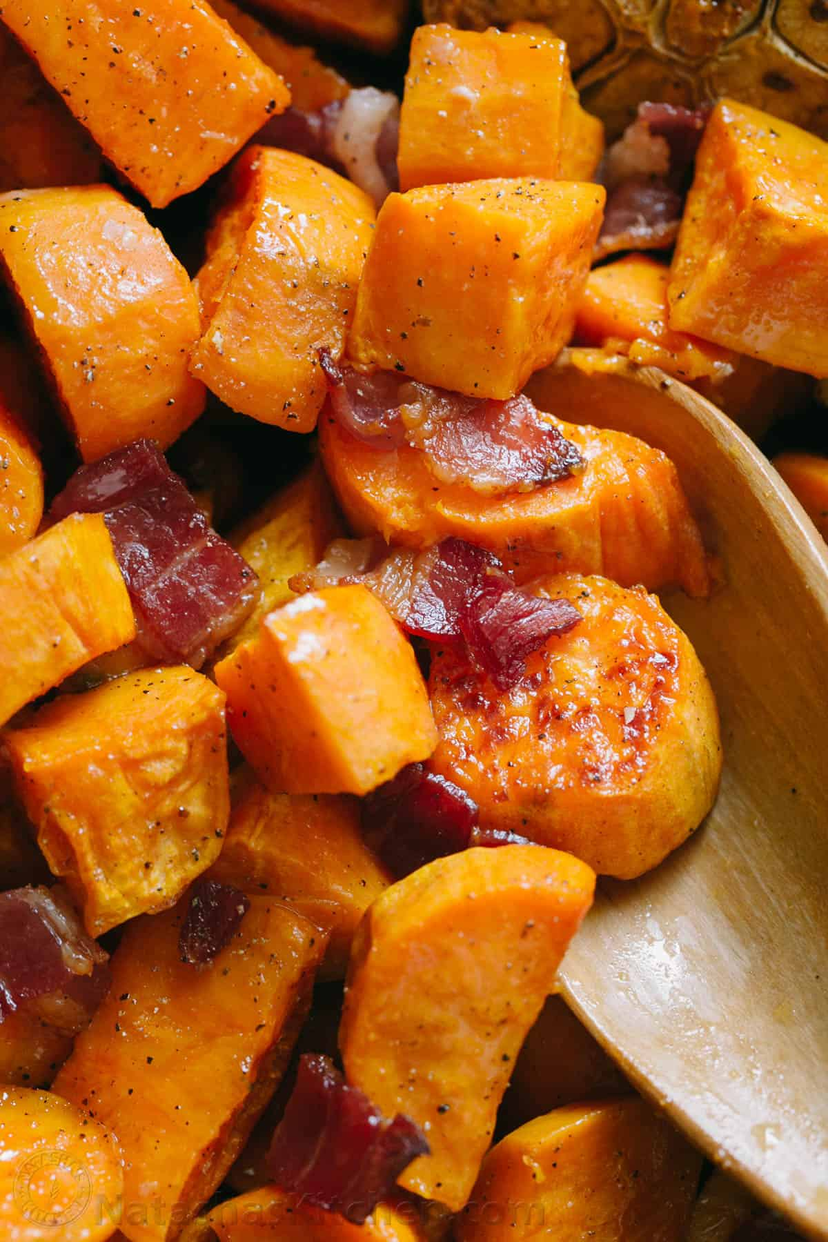 Maple Roasted Sweet Potatoes with bacon and spoon