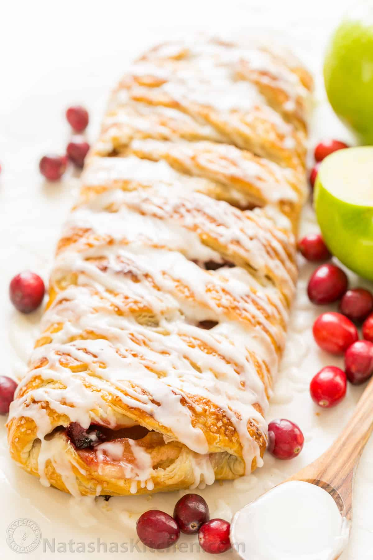 An Apple Danish Braid loaded with juicy caramelized apples and cranberries in a flaky pastry shell