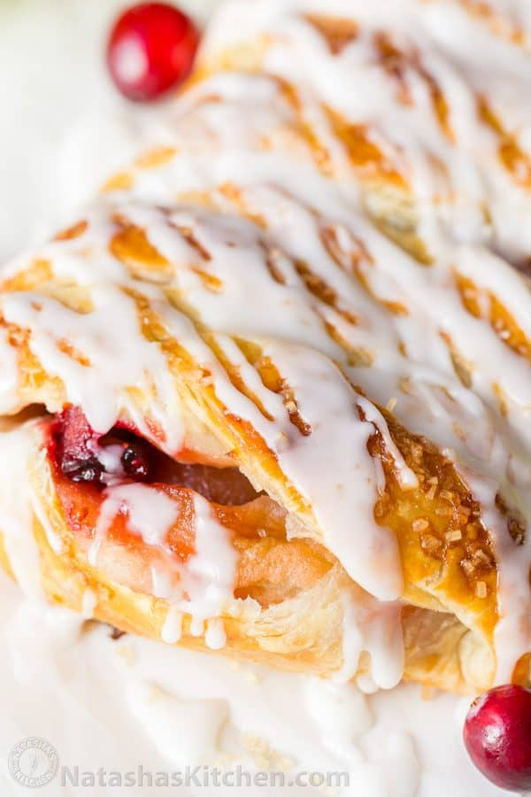 An Apple Danish Braid loaded with juicy caramelized apples and cranberries in a flaky pastry shell. This braided apple danish is easy and disappears fast!   natashaskitchen.com