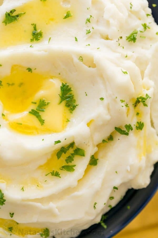 Creamy mashed potatoes recipe drizzled with butter