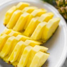 The prettiest and easiest way for How to Cut a Pineapple! Learn how to make pineapple boats for your next party and impress your friends! A video tutorial | natashaskitchen.com