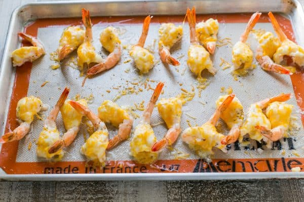 This is a fly-off-the-plate cheesy garlic shrimp appetizer and it's so easy to make! Easy, excellent butterflied shrimp appetizer! | natashaskitchen.com