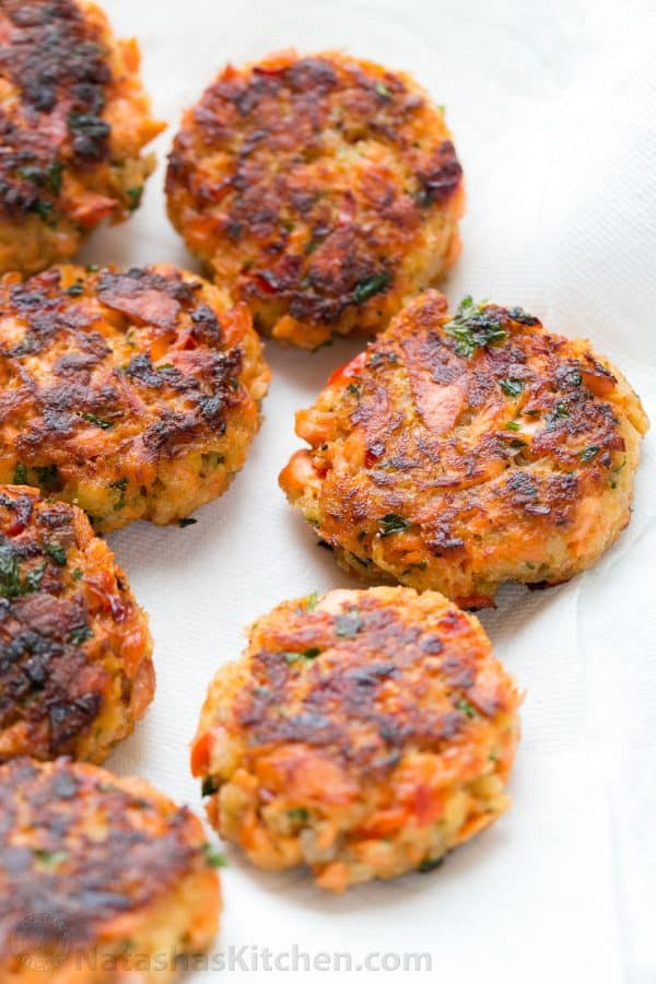 These salmon cakes are crisp on the outside with tasty bites of flaked salmon. They always disappear fast! SUPER EASY and truly delicious salmon cakes!   natashaskitchen.com