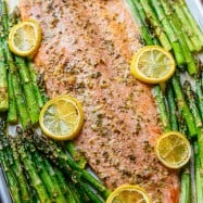 One Pan Salmon and Asparagus with Garlic Herb Butter is quick and easy (25 minute meal). The garlic-herb butter gives this salmon and asparagus rich flavor. | natashaskitchen.com