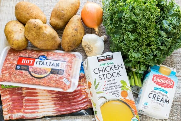 Garlic, kale, potatoes, onion and hot Italian sausage ingredients for zuppa toscana