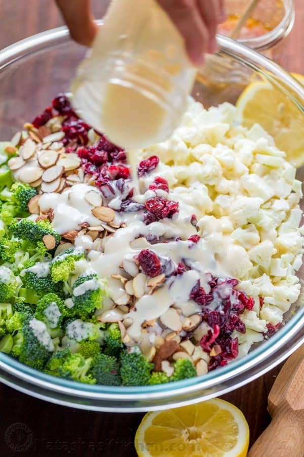 Creamy broccoli salad always gets rave reviews. Every bite of this creamy broccoli salad is coated in a honey-lemon dressing. Crisp, crunchy, chewy, tasty! | natashaskitchen.com