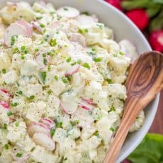 The most flavorful creamy potato salad recipe! This potato salad is loaded with fresh cucumber and radish - lighter and satisfying! Excellent and easy potato salad recipe | natashaskitchen.com #potatosalad #potatosaladrecipe #howtomakepotatosalad #potatoes