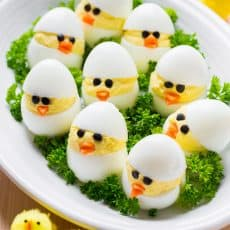 Easy and fun Easter Egg Recipe. A creative spin on traditional dressed eggs. Deviled egg chicks were the talk of my kitchen - the cutest Easter chicks! | natashaskitchen.com