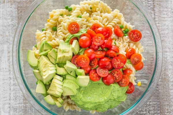 The secret ingredient in this Creamy Avocado Pasta Salad recipe will shock you! This avocado pasta salad is easy, creamy, vibrant, fresh and so satisfying! | natashaskitchen.com