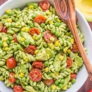 The secret ingredient in this Creamy Avocado Pasta Salad recipe will impress you! This avocado pasta salad is easy, creamy, vibrant, fresh and so satisfying! | natashaskitchen.com