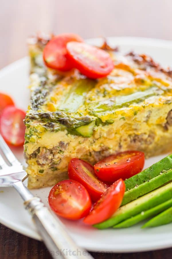 Every bite of this Sausage Asparagus Quiche is pure comfort. This classic quiche recipe is loaded with juicy sausage, eggs, fresh asparagus and herbs. | natashaskitchen.com