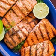 Break out the BBQ for this Grilled Salmon with Garlic Lime Butter and eat like you're on vacation! Go-To Grilled Salmon recipe - it excites your taste buds! | natashaskitchen.com