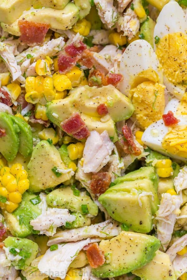 This Avocado Chicken Salad recipe with lemon dressing, plenty of avocado, irresistible bites of bacon and corn