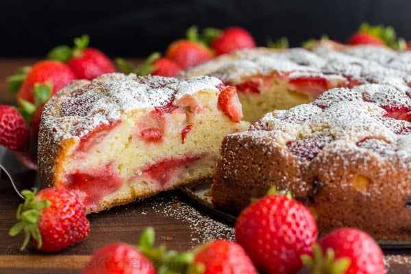 Easy Strawberry Cake recipe loaded with strawberries. So soft, lightly sweet, moist and bursting with strawberry flavor. Must-try easy strawberry syrup! | natashaskitchen.com