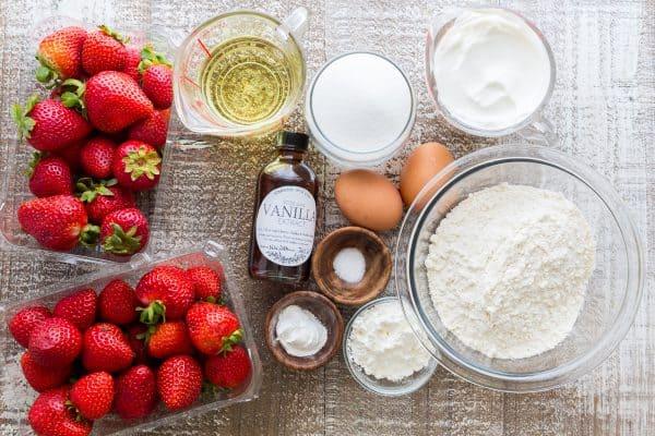 Easy Strawberry Cake recipe loaded with strawberries. So soft, lightly sweet, moist and bursting with strawberry flavor. Must-try easy strawberry syrup!   natashaskitchen.com