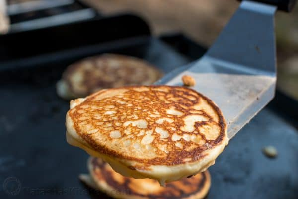 A close up of a pancake on a spatula