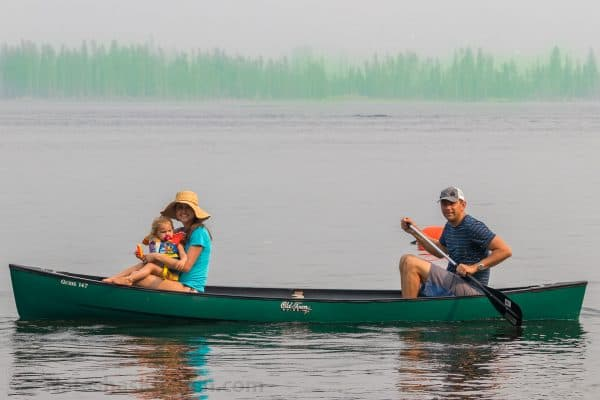 Natasha, her daughter, and husband canoeing