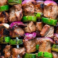These grilled steak kebabs are juicy and mouthwatering-delicious! It marinates overnight which makes the steak kebabs tender and so flavorful. | natashaskitchen.com
